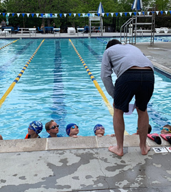 Billy Early coaching swimming